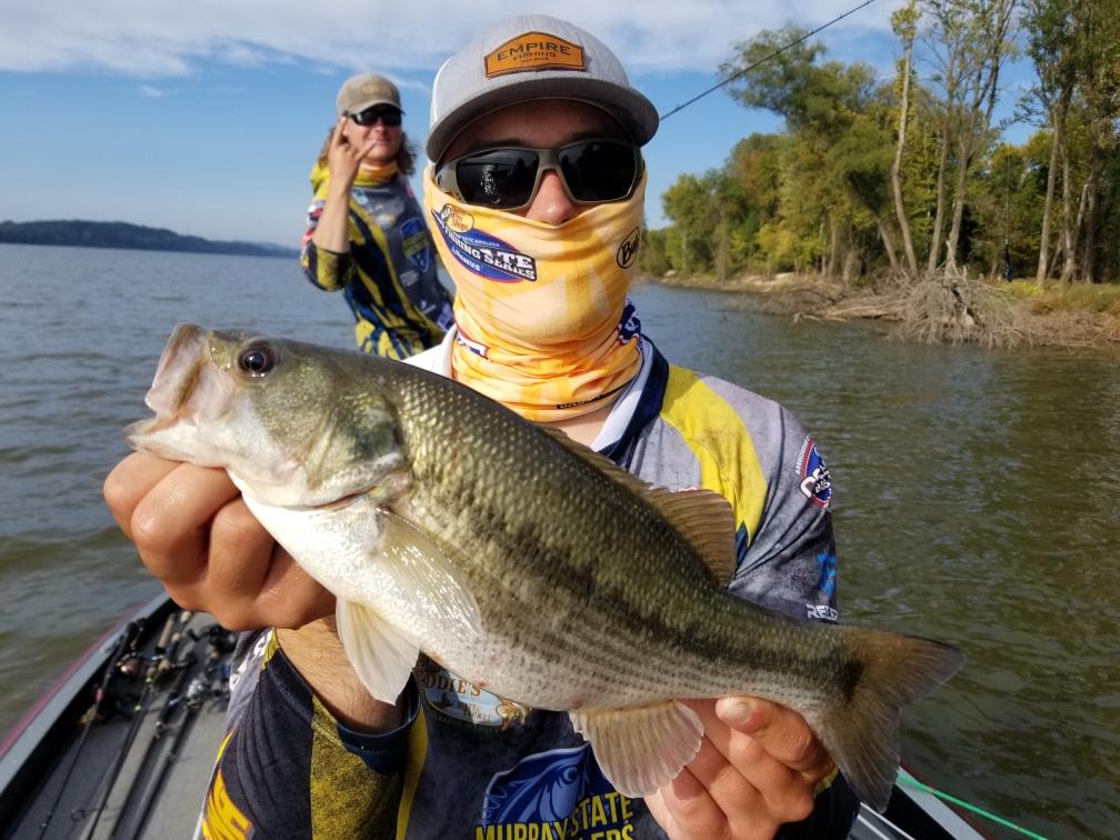 Collegiate Bass Fishing Angler Holding Bass