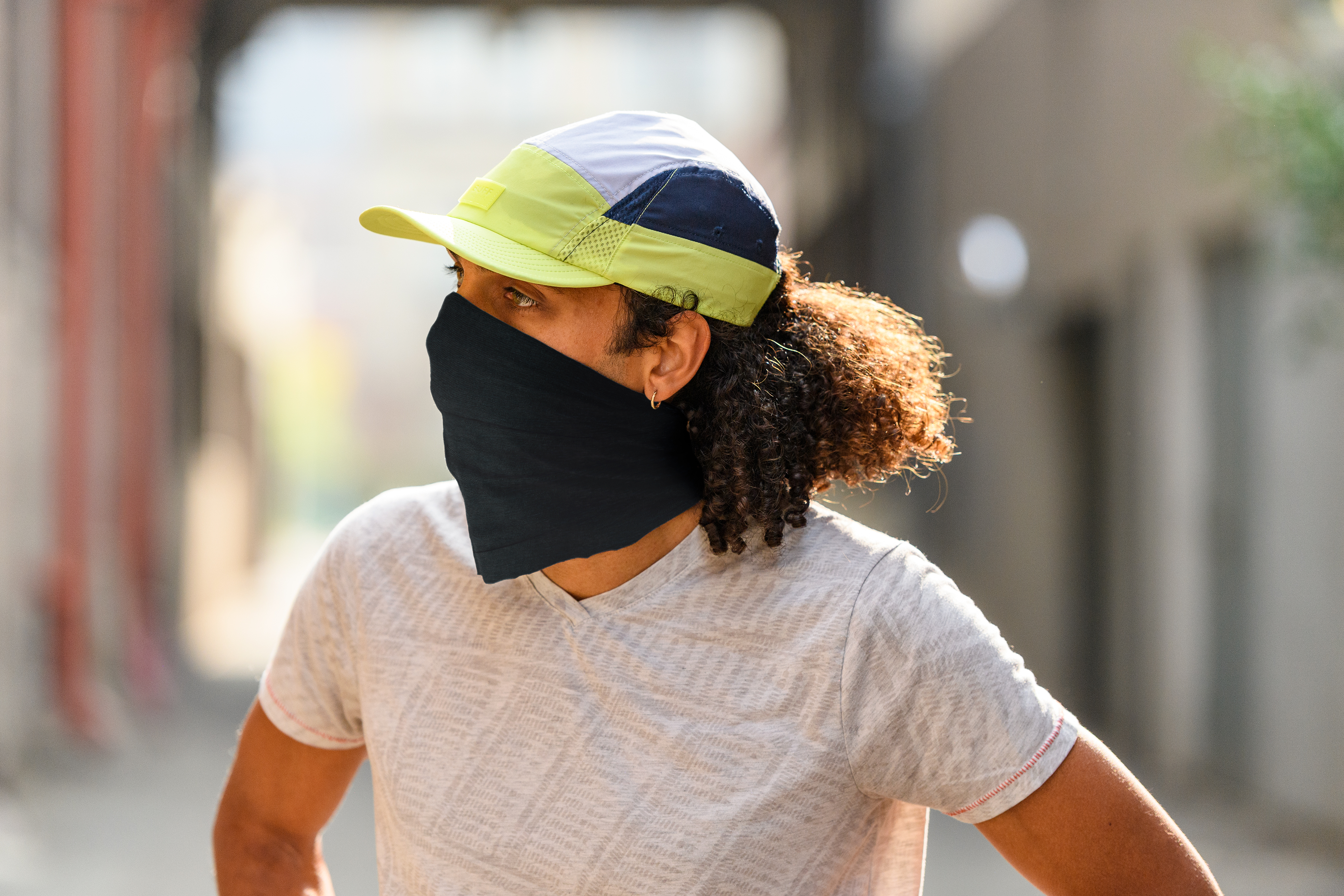 man in BUFF run cap