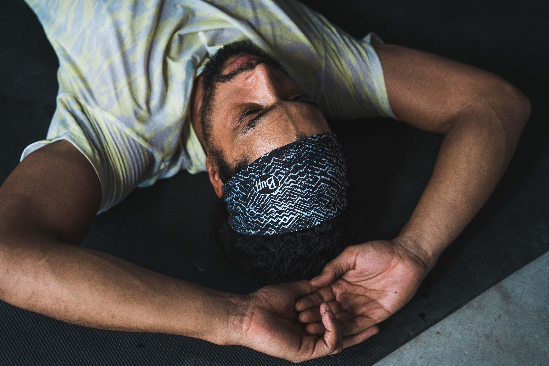 man on workout mat in BUFF® headband