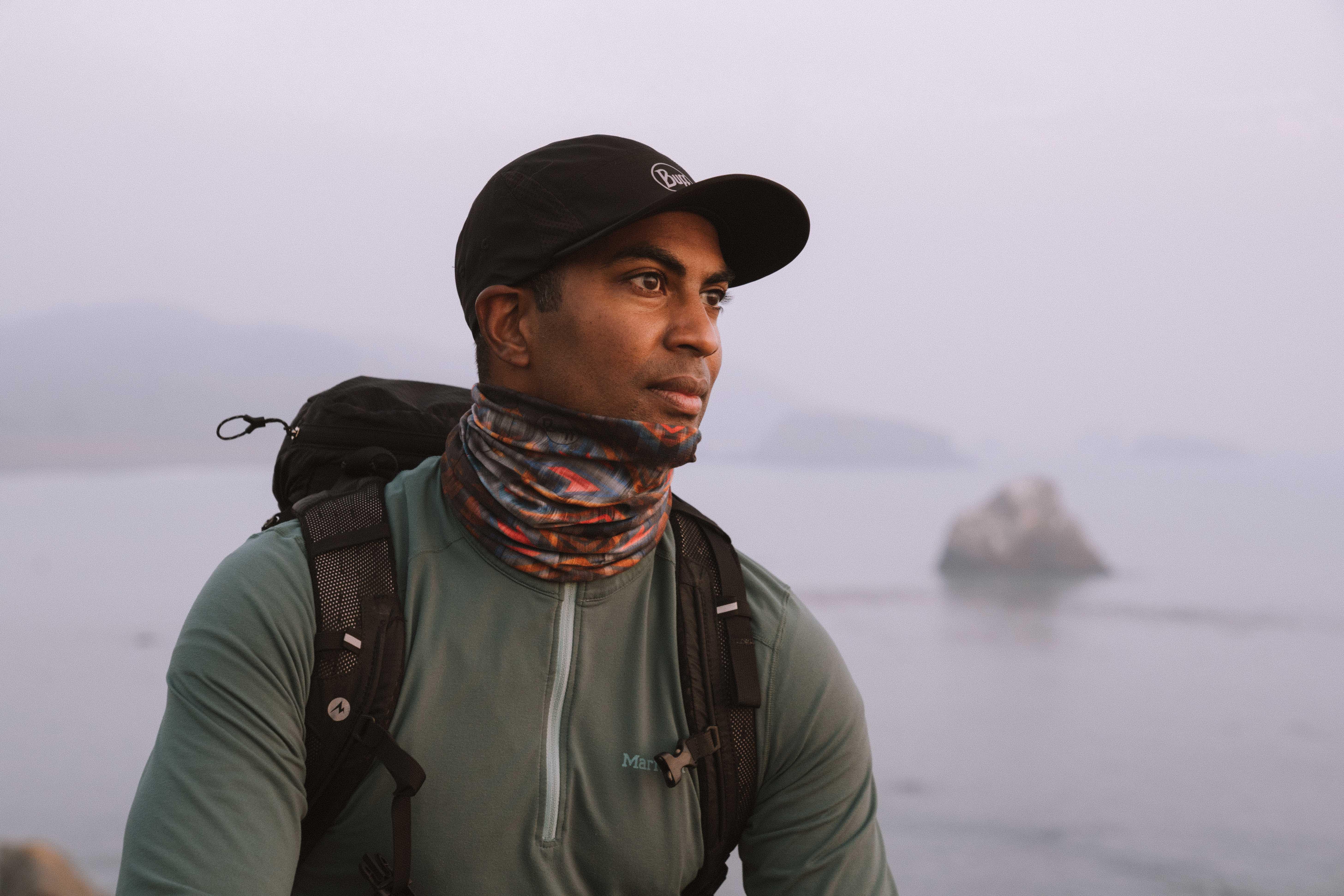 man hiking in BUFF neckwear