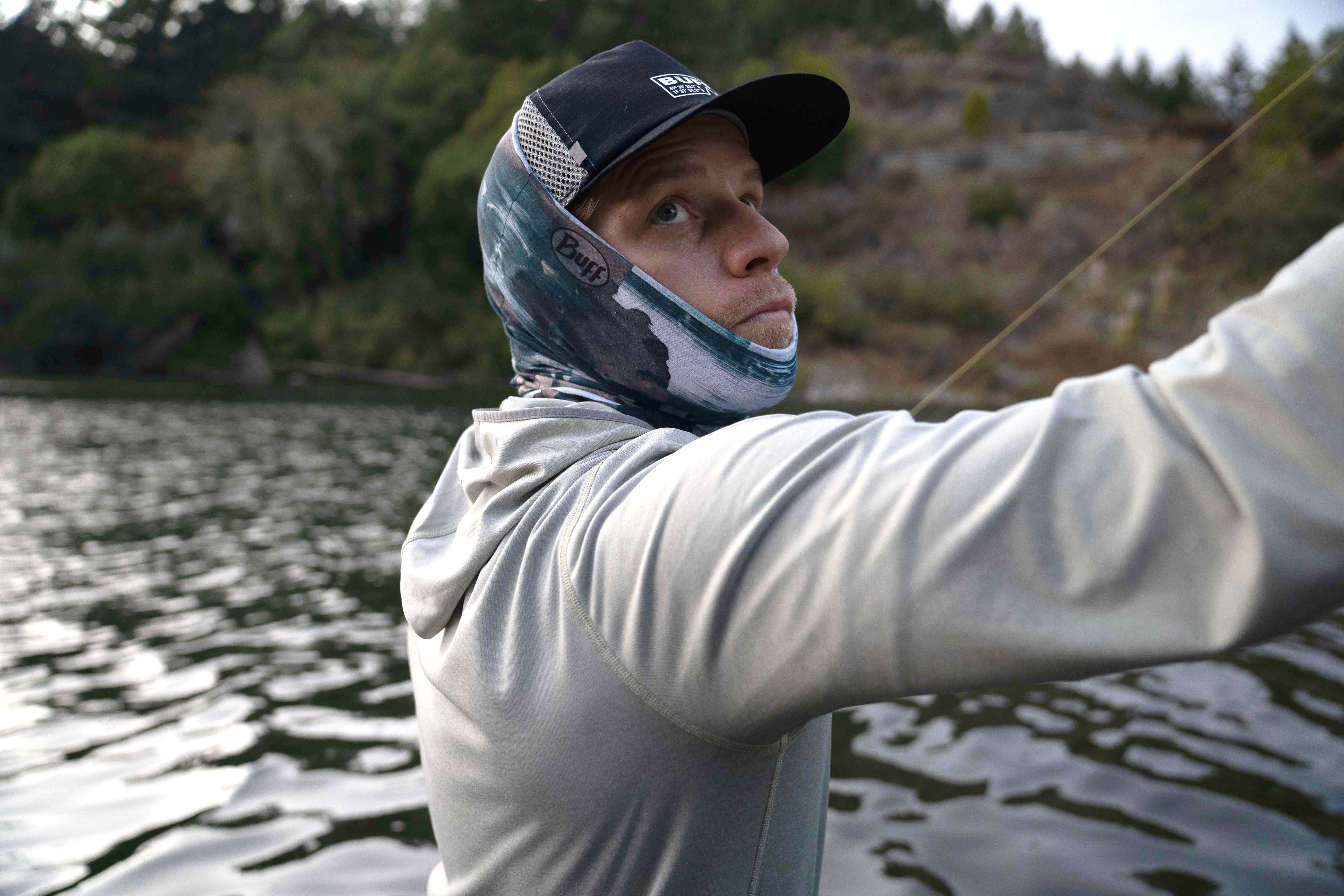 man casting fly fishing rod in BUFF product