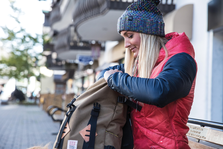 woman in BUFF winter gear in the city