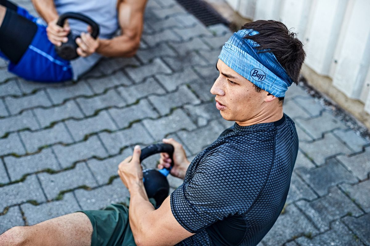 man working out in BUFF headband