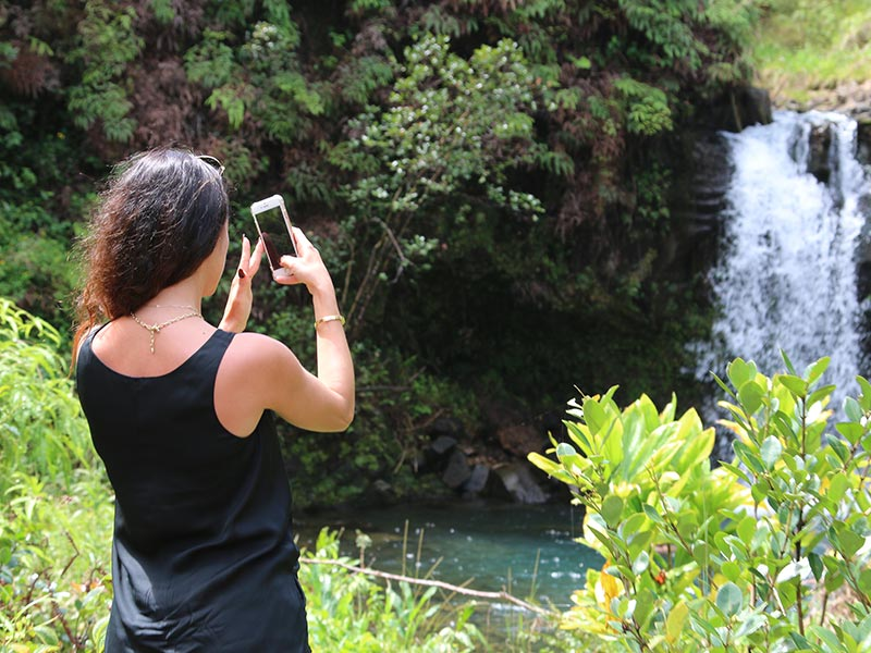 See waterfalls on the Road to Hana
